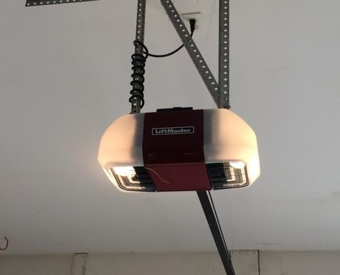 Red liftmaster garage door opener after being newly installed.