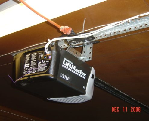 black liftmaster garage door opener after being installed on a garage door.